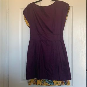 little Lady Dresses - Purple dress with yellow detail peaking out